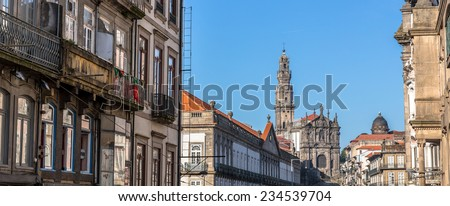 Panoramic of Porto with the Clerigos church and tower at the end of the street. - stock photo