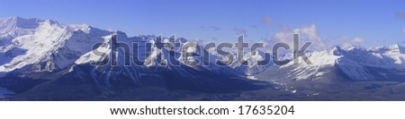 Panoramic of the rocky mountains in Banff National Park, Canada. Taken from Lake Louise Ski area. - stock photo