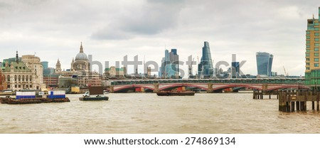 Panoramic overview of City of London with St Pauls Cathedral - stock photo