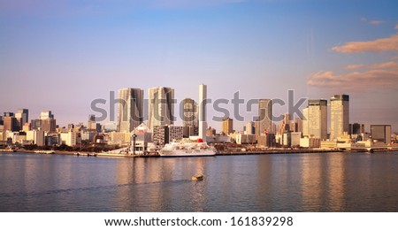 Panoramic photo of Tokyo City along ocean in a sunny day - stock photo