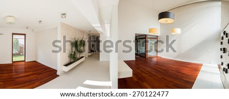 Panoramic photo of white hallway and wooden spacious lounge