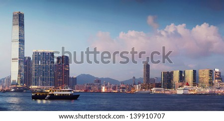 Panoramic picture Hong Kong bay with skysrapers on the coast