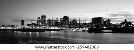 Panoramic Picture of Cityscape of Montreal, view at Pierre-Dupuy street behind the river, in Black and White image.. - stock photo