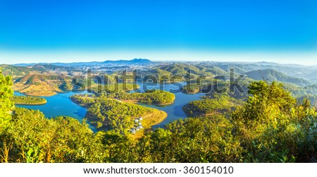 Panoramic plateau with early sunshine, vast lakes winding around mountains pine forests as giant bonsai beautiful, far away city Da lat famous tourism, it great to see sunrise proving this place - stock photo