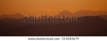 panoramic red sunset over the mountain ridge