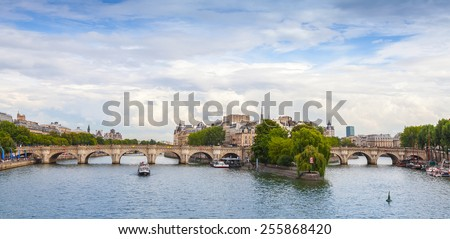 Panoramic rhoto of Cite Island and Pont Neuf, the oldest stone bridge across the Seine river in Paris, France - stock photo