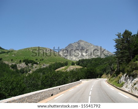 Panoramic road on high mountain with blue sky, Corse, France
