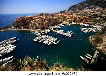 panoramic scenery of bay of Monaco with blue sky - stock photo