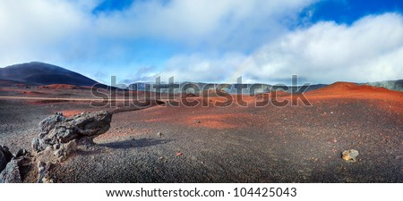 Panoramic scenic view of volcanic landscape, Plaine des Sables on Reunion Island.