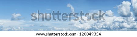 Panoramic shot of a blue cloudy sky - stock photo