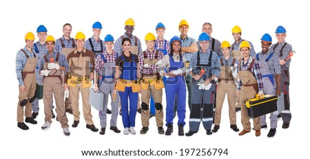 Panoramic shot of confident manual workers standing against white background
