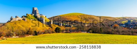 Panoramic shot of Corfe Castle in the village of the same name Dorset England UK Europe - stock photo