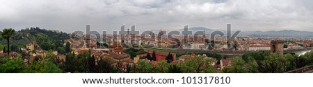Panoramic shot of Florence seen from Michelangelo square: Arno River, Old Palace, Old Bridge and much roofs of cities buildings. - stock photo