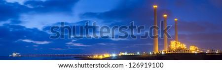 Panoramic shot of Power plant at sunset - stock photo