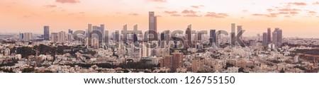 Panoramic shot of Tel Aviv and Ramat Gan Skyline at sunset - stock photo