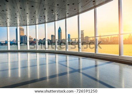 Panoramic skyline and buildings in shanghai from glass window