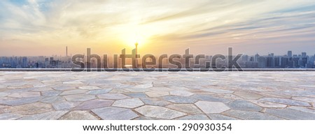Panoramic skyline and buildings with empty brick square  - stock photo