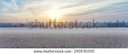 Panoramic skyline and buildings with empty road - stock photo