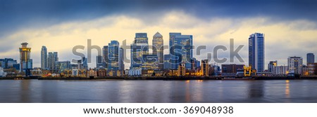 Panoramic skyline of Canary Wharf, the worlds leading financial district at blue hour - London, UK - stock photo