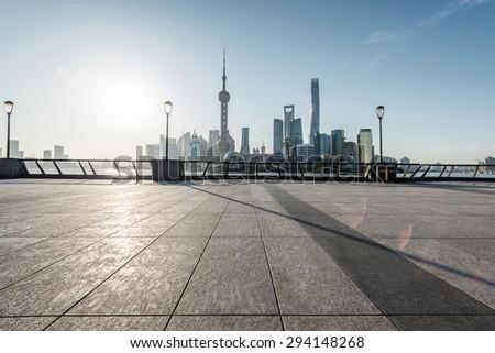 panoramic skyline of shanghai with empty street floor - stock photo