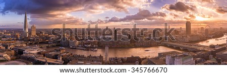 Panoramic skyline of south part of London with beautiful dramatic clouds and sunset - UK - stock photo