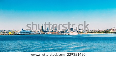 Panoramic Skyline Of Tallinn And Harbour, Coast With Blue Clear Sky At Sunrise, Estonia. View From Sea, Gulf Of Finland - stock photo