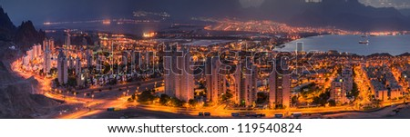 Panoramic spectacular view on the night cities of Eilat (Israel) and Aqaba (Jordan)   - stock photo