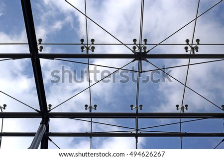 Panoramic structural glass roof. Modern office architecture with modular fragmentation / regular framework.