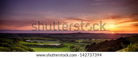 Panoramic sunset over England with rolling landscape - stock photo