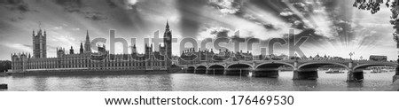 Panoramic sunset over Westminster Bridge with bus crossing. Processed in black and white - stock photo