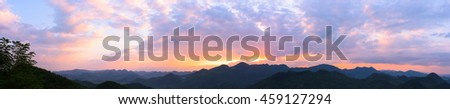Panoramic sunset with colorful clouds  - stock photo