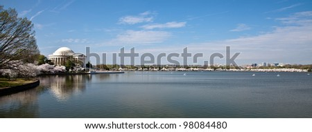 Panoramic veiw of cherry blossoms around the Tidal Basin in Washington DC with Jefferson Memorial - stock photo