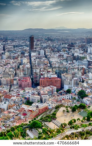 Panoramic view Alicante city center with mountains chain on background, Spain