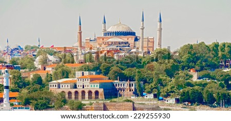"Panoramic view at Hagia Sophia  ""Holy Wisdom"". It is a former Greek Orthodox patriarchal basilica (church), later an imperial mosque, and now a museum in Istanbul, Turkey.  - stock photo"