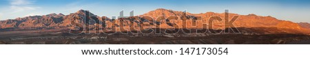 Panoramic view at hills lighted by sunset light in Death Valley, California, USA - stock photo
