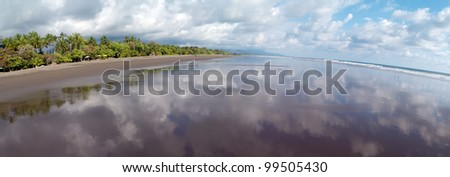 Panoramic view at the beach of Matapalo, Costa Rica. Matapalo is located in the Southern Pacific Coast. The main attractions are surfing and eco-tourism., Matapalo - stock photo