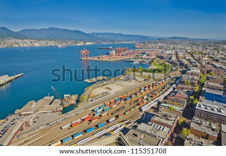 Panoramic view city of Vancouver with the container port terminal and freight station with trains, oil-cars, tank-cars - stock photo