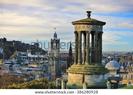 Panoramic view from Calton Hill. Dugald Stewart monument in the foreground, Scott monument and Balmoral clock tower in background. Edinburgh Castle and city, Scotland, United Kingdom.