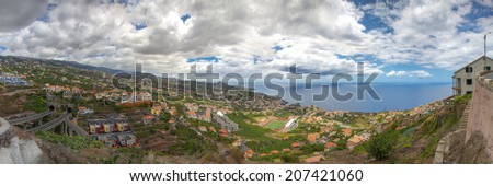 Panoramic View from Camara de Lobos to Sao Martinho, Madeira.de view over the valley with the ocean in the background and clouds in the sky - stock photo