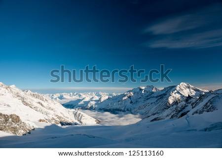 Panoramic view from Mittelallalin, Saas Fee, Valais, Switzerland - stock photo