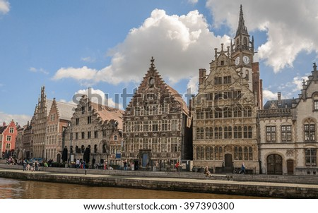 Panoramic view from one side of promenade to the famous buildings and old architecture the Leie river in the historic city center with channel and embankment (Graslei and Korenlei), Ghent, Belgium