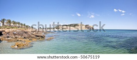 Panoramic view from the beach at Luz in the Algarve in Portugal - stock photo