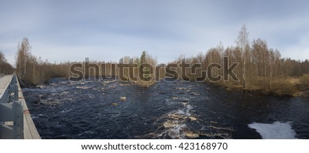 Panoramic view from the bridge on a stormy river - stock photo