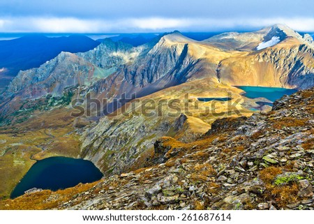 Panoramic view from the height of bird's flight over the lakes and mountains.  Picture was taken during trekking hike in scenic and gorgeous Caucasia at autumn, Arhiz region,Karachay-Cherkessia,Russia - stock photo