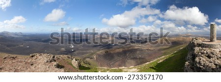 Panoramic view from the Montana de Guardilama: left the villages Uga and Yaiza, below the wine-growing area La Geria, on the right the east coast of Lanzarote, Canary Islands, Spain.  - stock photo