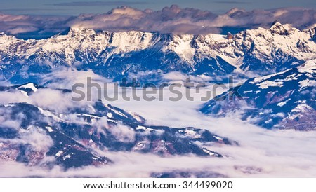 Panoramic view from the top of Kaprun glacier at sunny winter morning in Austrian alps, Tyrol, Austria - stock photo