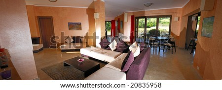 Panoramic view in a motel lobby with modern sofa and table - stock photo