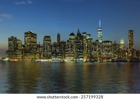 Panoramic view New York City Manhattan downtown skyline at night with skyscrapers - stock photo