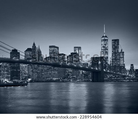 Panoramic view New York City Manhattan downtown skyline at night with skyscrapers and blue tonality - stock photo