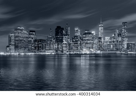 Panoramic view New York City Manhattan downtown skyline at night with skyscrapers and blue tonality